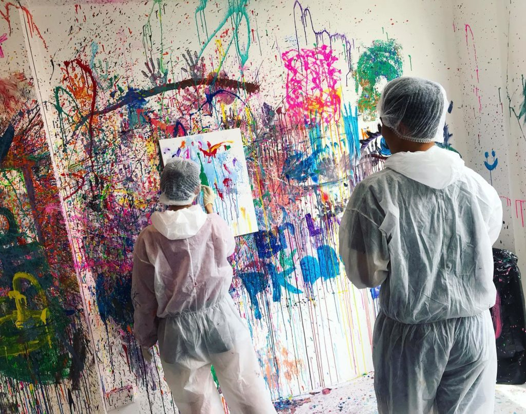 two participant trying splat painting
