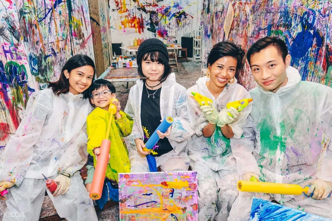 Group taking photo at Splat Paint House