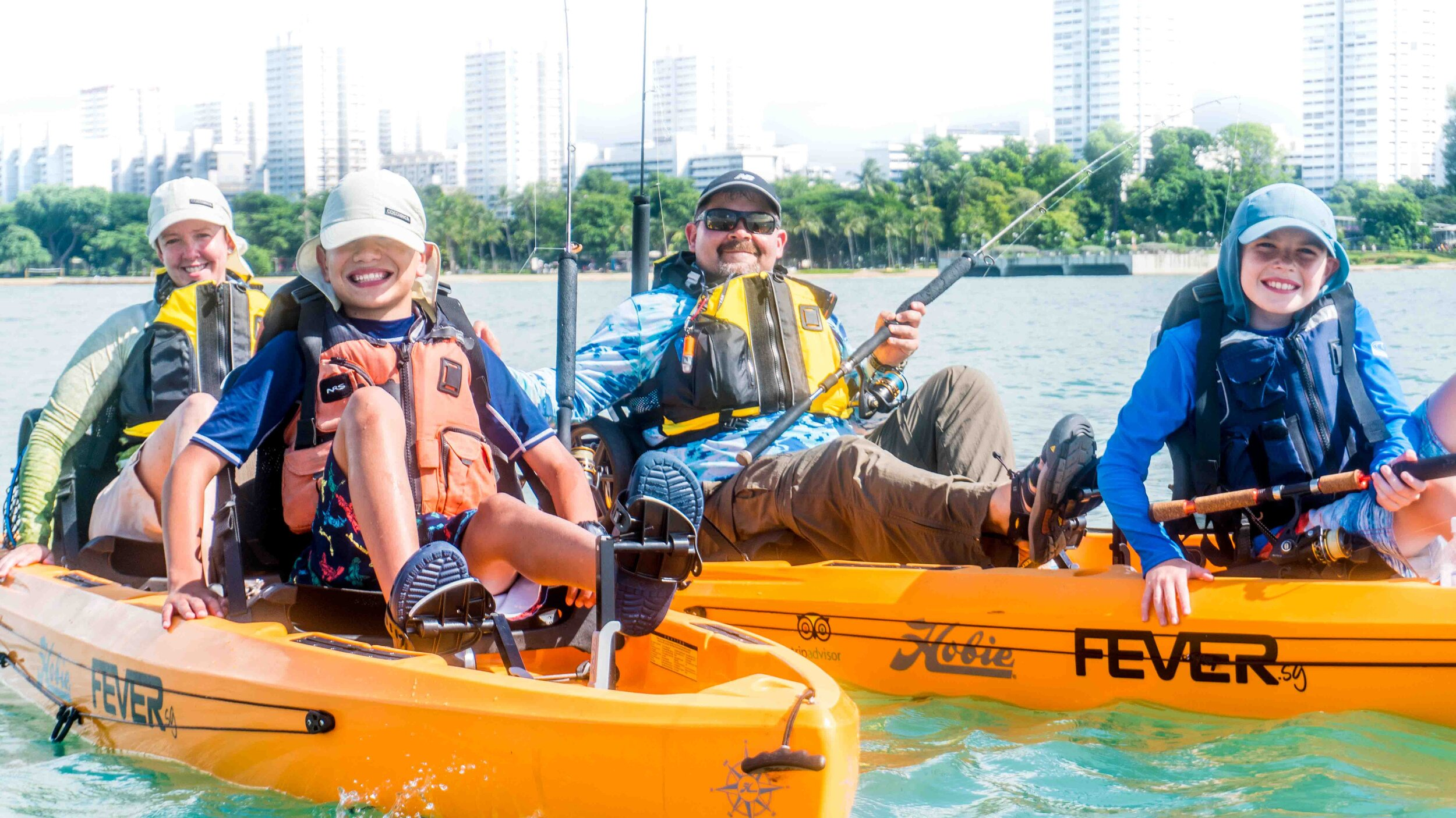 group of kayakers posing on kayaks
