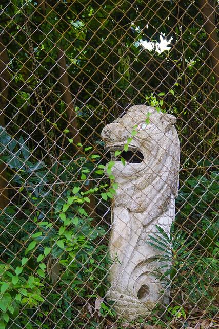 abandoned merlion statue at changi airbase