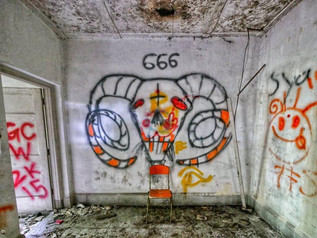 devilish graffiti in abandoned Istana Woodneuk