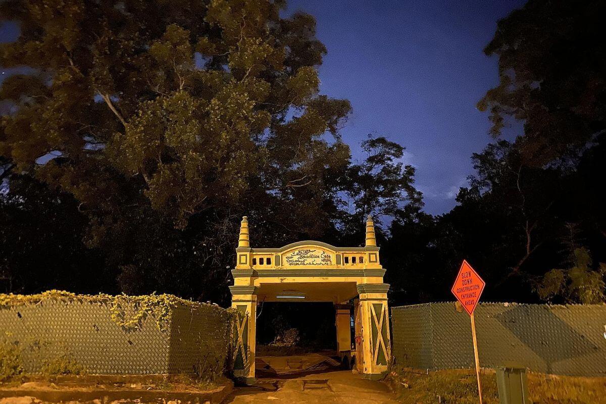 Yellow gates of Kubur Kassim cemetery