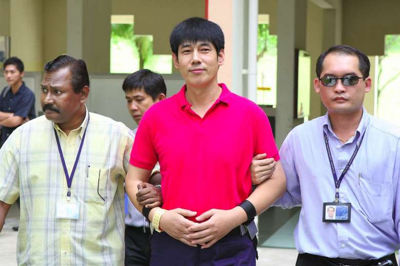 Wang zhijian being escorted by police at Yishun Triple Murder