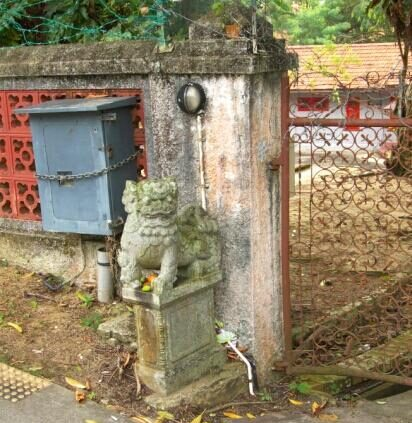 Stone lion statue at Pasir Ris haunted red house